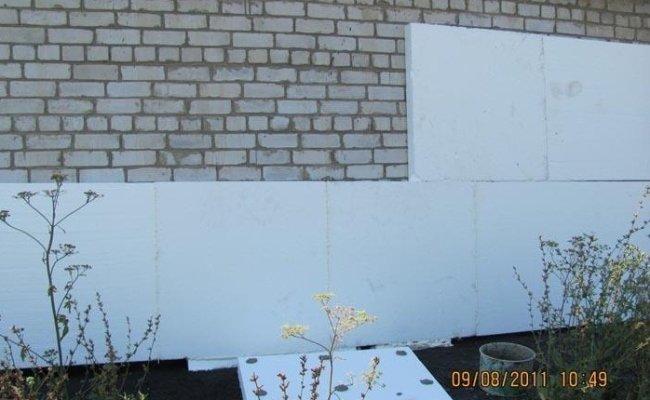 Porte de garage isolante avec portillon leroy