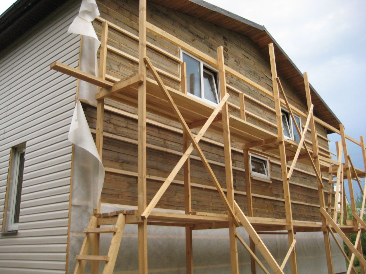 Утепляем фасады деревянного здания