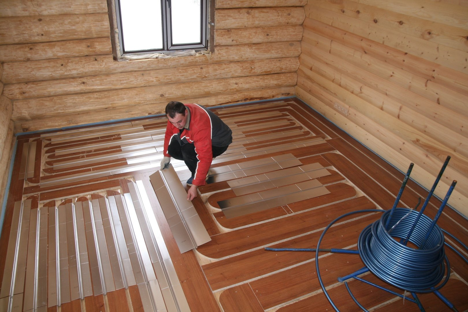 Как сделать теплый пол в доме под ламинат